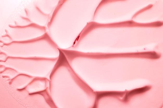 Close-up van een artistieke geweven perzikkleurachtergrond