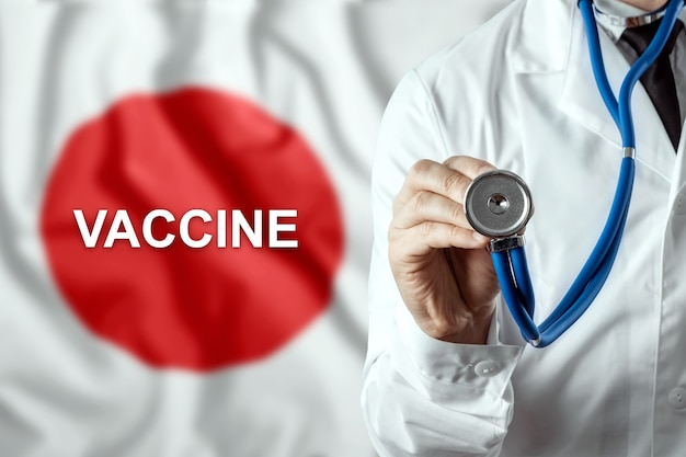 Close-up van een arts en het woordvaccin