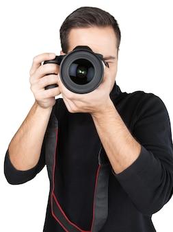 Close-up van een fotograaf die foto's maakt