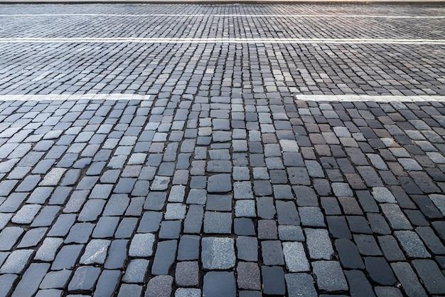 Close up van een geplaveide weg voor achtergronden. straatbestrating achtergrond, rotstextuur