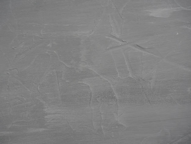 Close-up van een gestructureerde grijs gekleurde achtergrond. kopieer ruimte