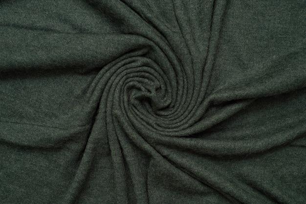 Close up van een groene gebreide stof