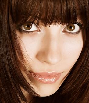 Close-up van een mooie gezichts jonge vrouw