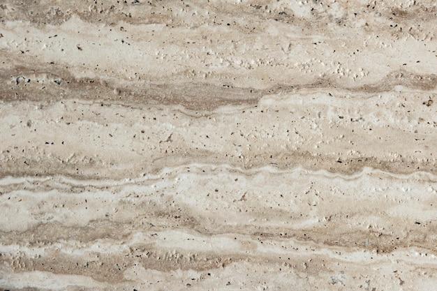 Close-up van een natuursteen met gaten