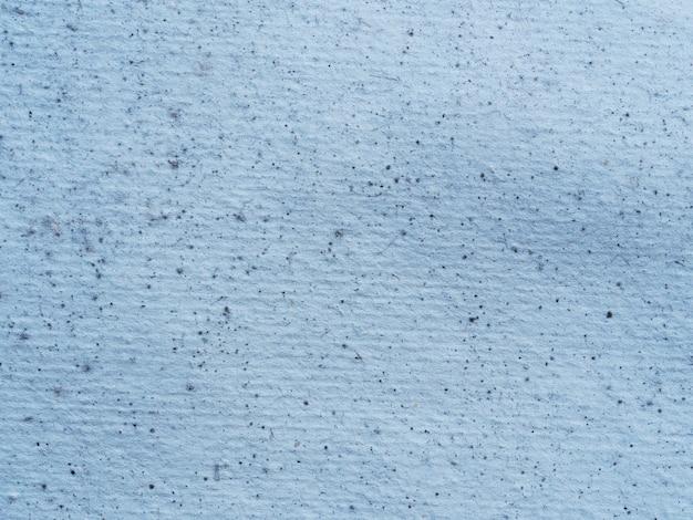 Close up van een papieren textuur bedekt met meeldauw