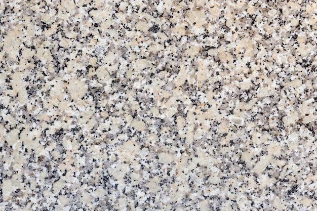Close-up van een textuur van een muur gemaakt van steen en graniet
