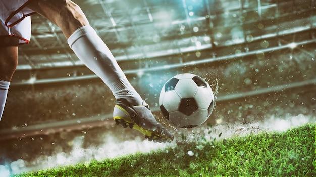 Close-up van een voetballer die de bal trapt