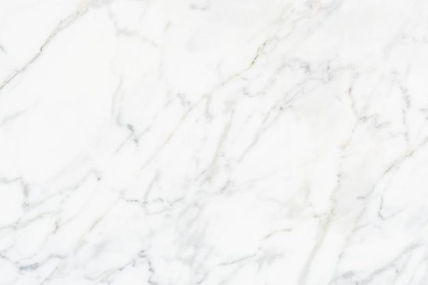 Close up van een witte marmeren getextureerde muur