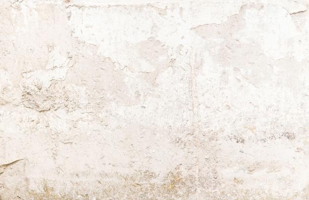 Close-up van getextureerde grijze betonnen muur. vuile betonnen structuur.