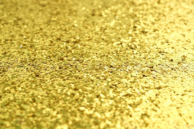 Close-up van gouden glanzende glitter oppervlak, make-up of cosmetica concept