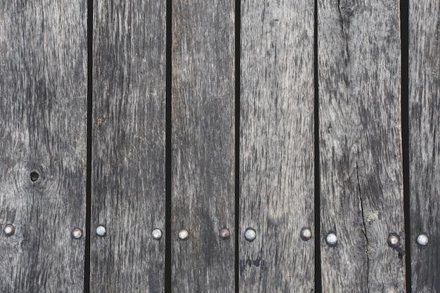 Close up van grijze houten hek panelen