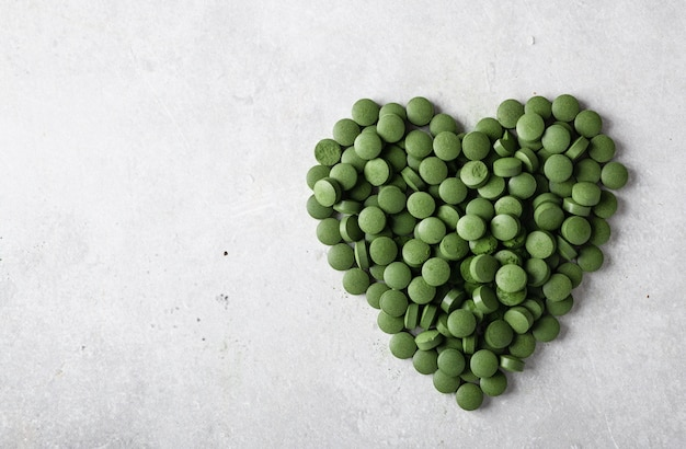 Close-up van groene chlorellapillen