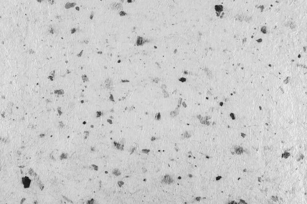 Close-up van handgeschept papier textuur vintage achtergrond met blad. zwart en wit.