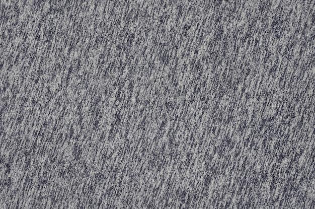 Close-up van kachel en gebreide geweven de doekachtergrond van de jerseystof met gevoelig gestreept patroon