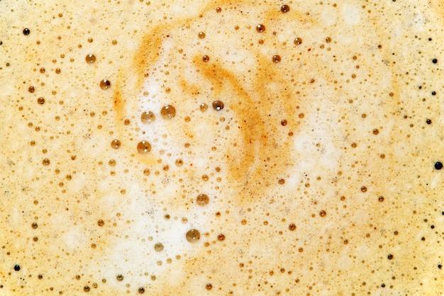 Close-up van koffieschuim als achtergrond