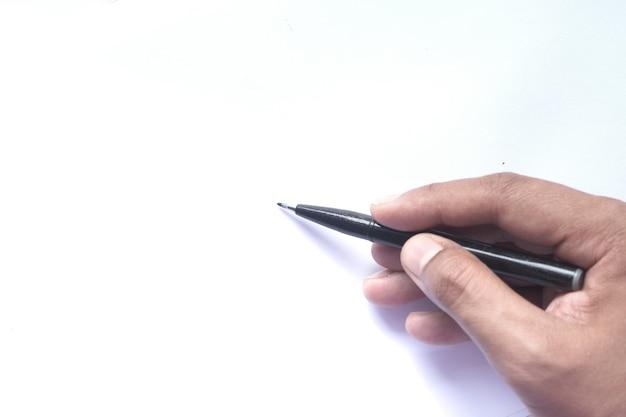 Close up van man hand schrijven op een witboek