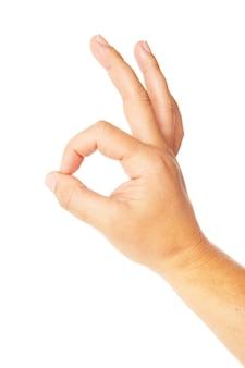 Close-up van mans hand gebaren - teken ok oke tonen