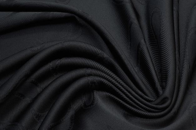 Close up van mooie rimpel zwarte stof textuur.