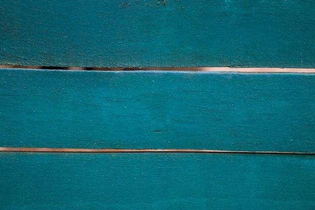 Close-up van oude blauw geschilderde verweerde houten textuur.