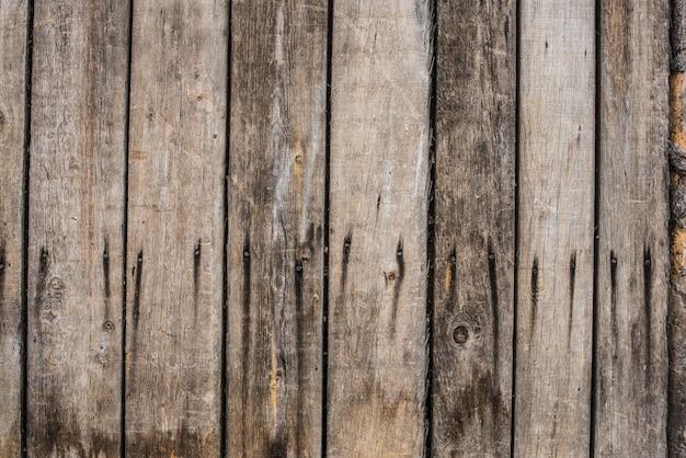 Close-up van oude grijze houten omheiningspanelen