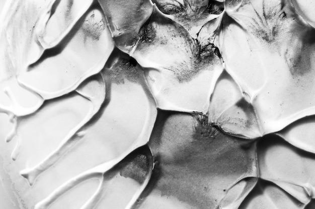 Close-up van oude zwart-witte gebarsten geweven muur