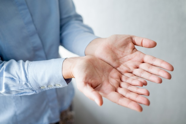 Close-up van person outstretching hands together