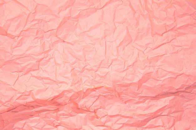 Close-up van roze rimpel verfrommeld oud met papier pagina textuur ruwe achtergrond.