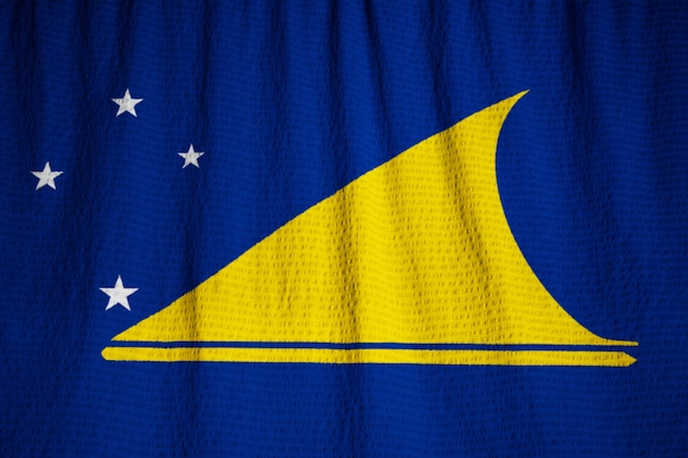 Close-up van ruffled tokelau vlag, tokelau vlag waait in de wind