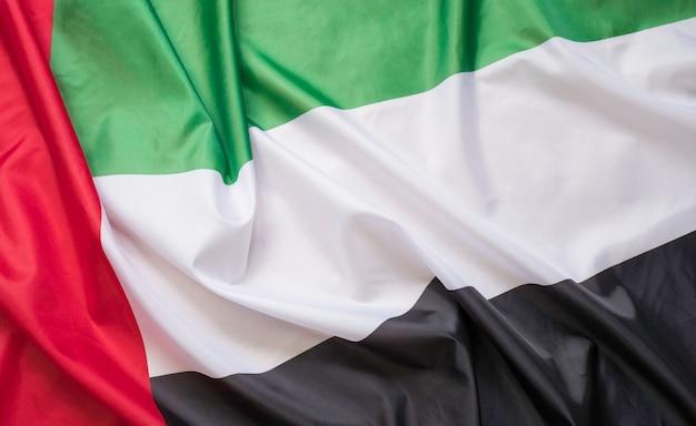 Close up van stof textuur van de vlag van verenigde arabische emiraten.