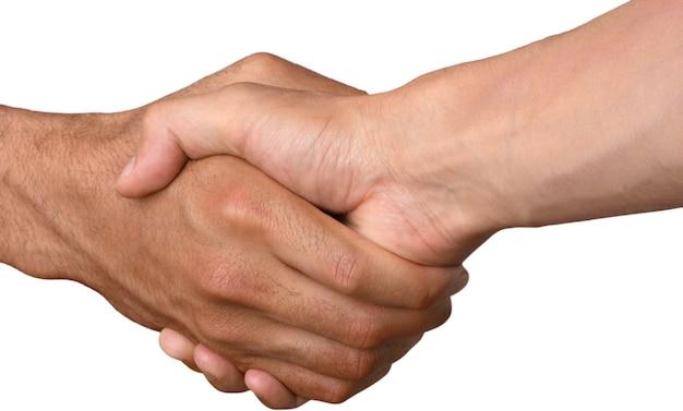 Close-up van twee mannen die elkaar de hand schudden