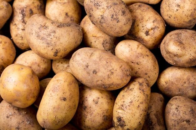 Close-up van verse aardappelen als achtergrond