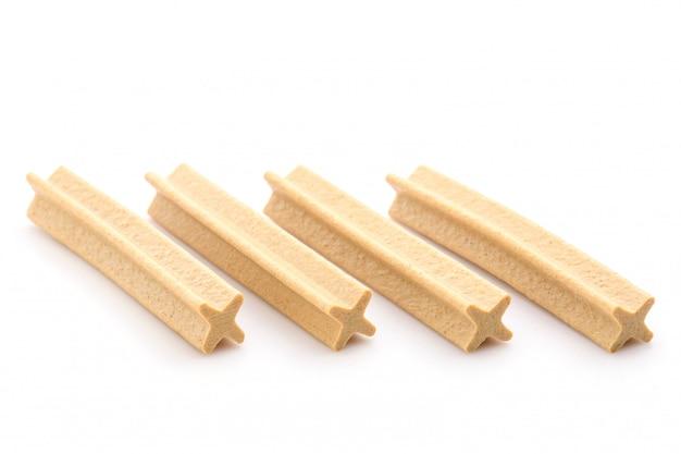 Close-up van x-shape tandheelkundige stok voor puppy
