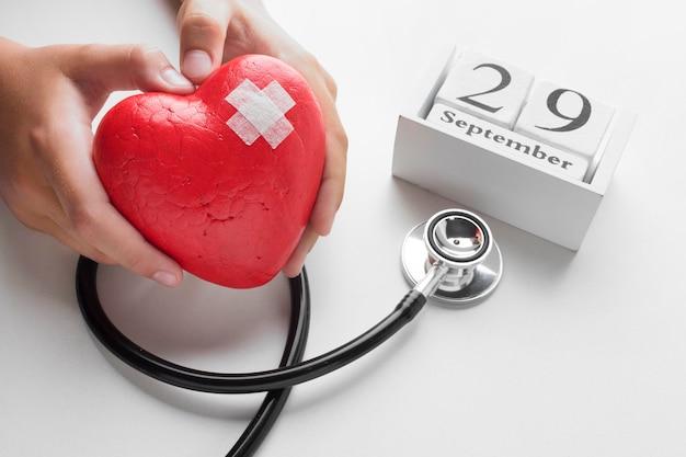 Close-up wereld hart dag concept met stethoscoop