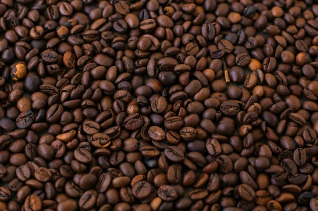 Close-upachtergrond van koffiebonen