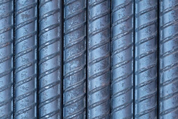 Close-updetail van de oppervlakteachtergrond en textuur van staalstaven