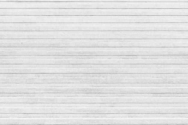 Close-uphoek van de openlucht marmeren traptextuur van witte steentreden.