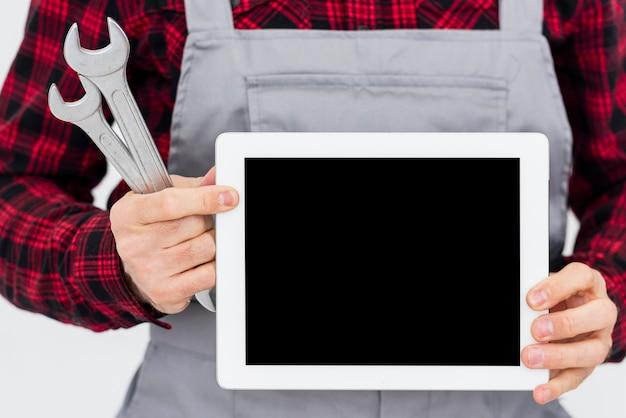 Close-upmonteur met tablet