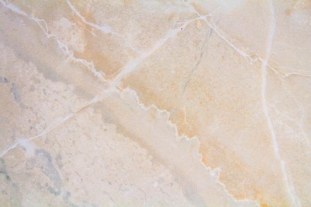 Close-upoppervlakte van marmeren patroon bij de marmeren achtergrond van de vloertextuur, geel abstract marmeren patroon