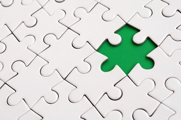Close-uptextuur van een witte puzzel in samengestelde staat
