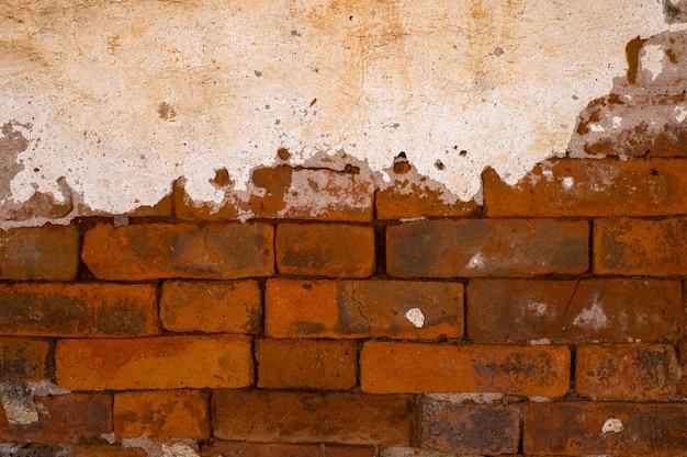 Closeup oude grungy bakstenen muur betonnen textuur achtergrond