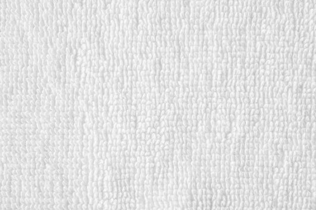 Closeup witte katoenen handdoek textuur abstracte muur
