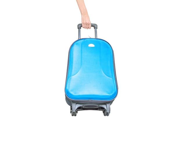 Clsoeup blauwe die bagage met hand op witte achtergrond wordt geïsoleerd