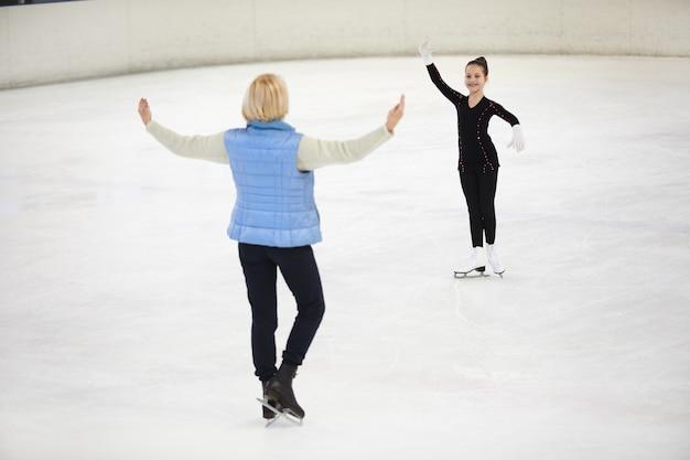 Coach training little figure skater