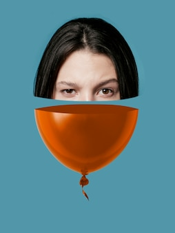 Collage met halve ballon en half gezicht
