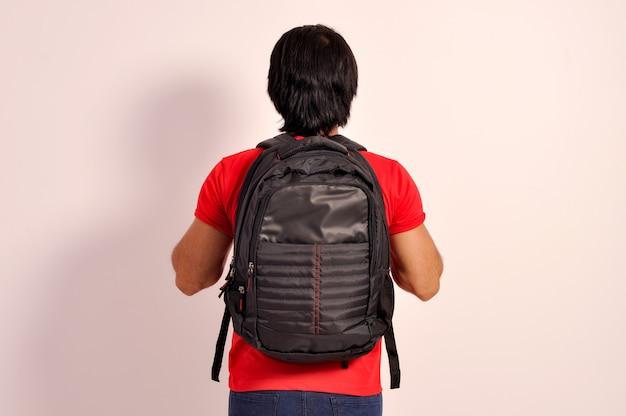 Collage student tiener jongen met rugzak staande achteraanzicht