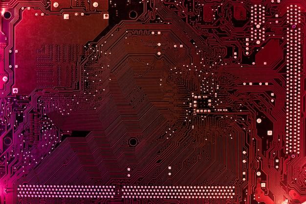 Computermotherboard met de veelkleurige gloed van het onduidelijk beeldneon, pc-achtergrond