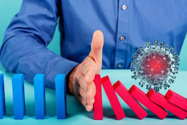Concept covid19 coronavirus pandemie met vallende ketting als een dominospel. besmetting en infectieprogressie gestopt door een arts. cyaan muur