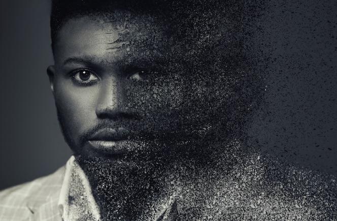 concept portret van een afro-amerikaanse man met verspreidingseffect.