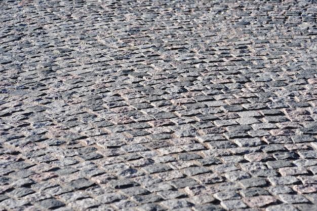 Concept van het leggen van straatstenen en tegels