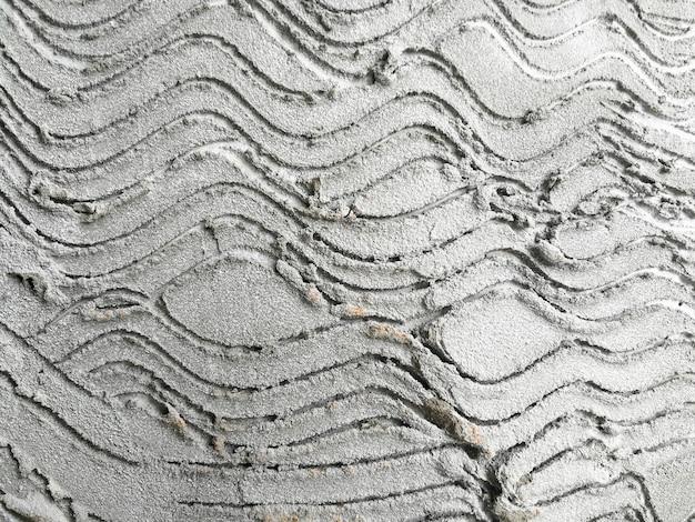 Concrete de textuurachtergrond van de poetsmiddelmuur.